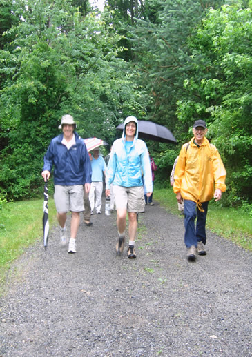 Peter (right) leads the hikers.
