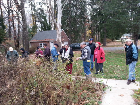 Hikers gather outside the Lawrence Nature Center